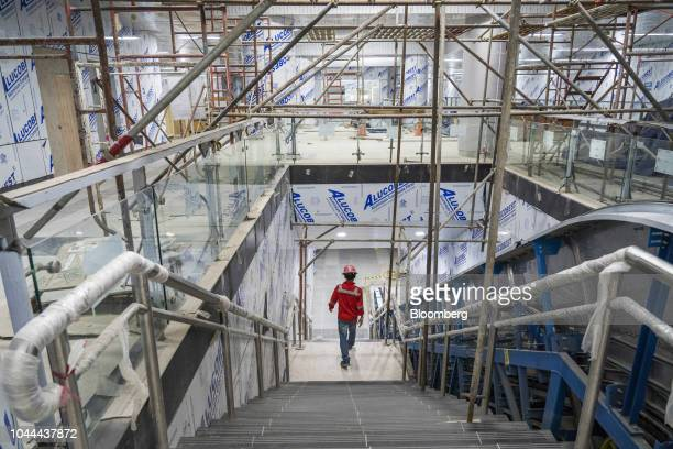 A worker walks down a flight of stairs at the under construction Jakarta Mass Rapid Transit Bundaran Hi station in the Thamrin area of Jakarta...