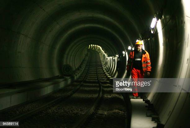 A worker walks in a subway tunnel on a Bilfinger Berger AG building site in Hamburg Germany Monday March 19 2007 Germany's secondlargest builder said...