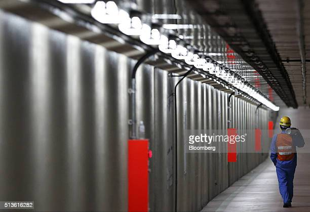A worker walks in an underground passage in the Keihin Industrial Zone in Kawasaki Kanagawa Prefecture Japan on Thursday March 3 2016 The Japanese...