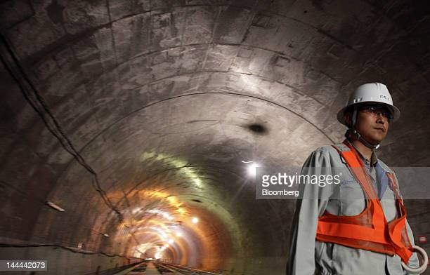 A worker walks in the Akiyama tunnel which is under construction for Central Japan Railway Co's magneticlevitation train line in Uenohara City...