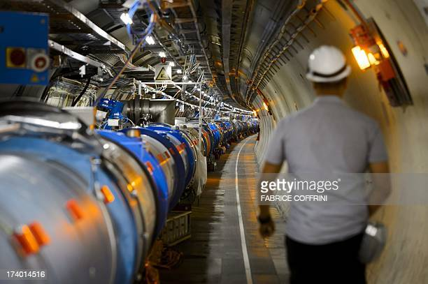 A worker walks in the CERN's Large Hadron Collider tunnel during maintenance works on July 19 2013 in Meyrin near Geneva Tests at the world's biggest...