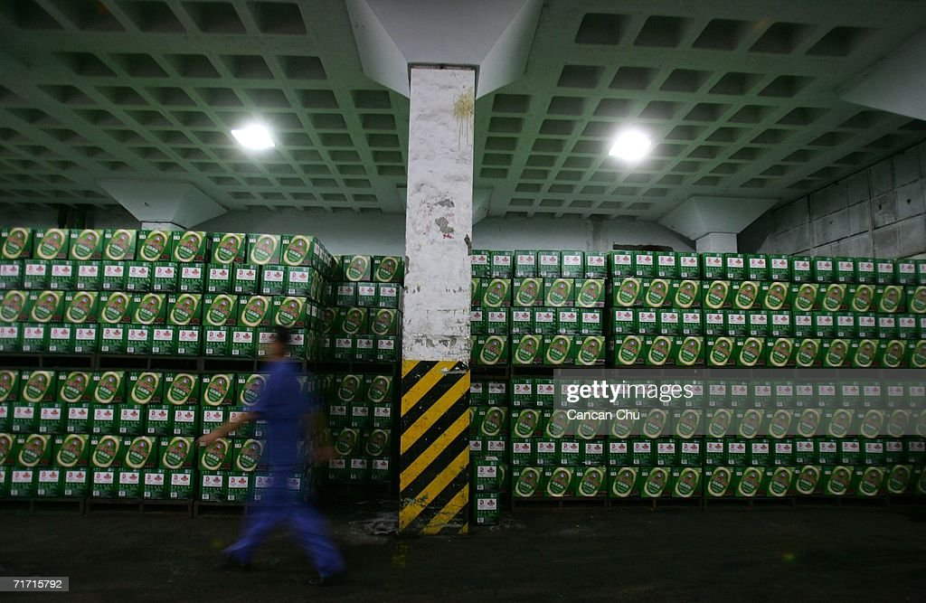 A worker walks in the storehouse of the Tsingtao beer factory on August 25, 2006 in Qingdao, Shandong Province of China. Tsingtao Beer Group, China's biggest beer brewery and the Official Domestic Beer Sponsor of the Beijing 2008 Olympic Games, hosts the 16th Qingdao International Beer Festival in Qingdao from August 12 to 26.
