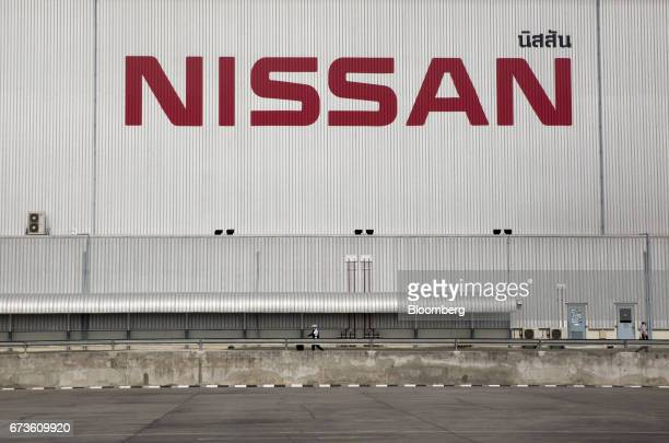 A worker walks outside the Nissan Motor Co plant in Samut Prakan Thailand on Tuesday April 25 2017 Nissan andMitsubishi Motors Corpstill have a...