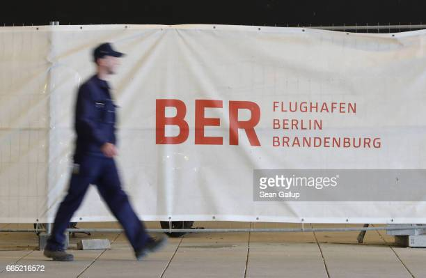 A worker walks past an active construction area at the stillnotfinished BER Willy Brandt Berlin Brandenburg International Airport on April 6 2017 in...