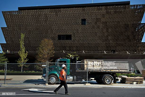 A worker walks past as construction continues on the Smithsonian's National Museum of African American History and Culture August 30 2016 in...