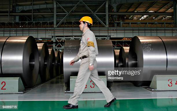 A worker walks past rolled steel at the BaosteelNSC/Arcelor Automotive Steel Sheets Co plant in Shanghai China Tuesday November 8 2005 The US asked...