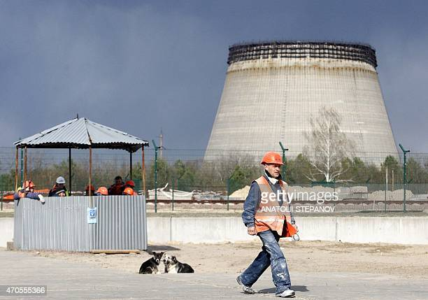A worker walks past the construction site of a nuclearfuel storage facility next to the Chernobyl Nuclear Power plant on April 21 2015 The New Safe...