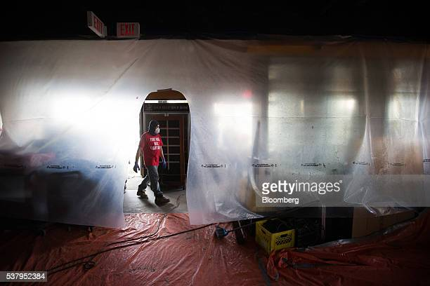 A worker walks through a brewery restaurant that was damaged by wildfire in Fort McMurray Alberta Canada on Friday June 3 2016 Residents began...