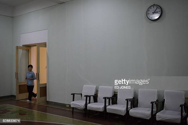 A worker walks through a hallway at the Pyongyang Maternity Hospital during a governmentorganised media tour in Pyongyang on May 7 2016 North Korea...