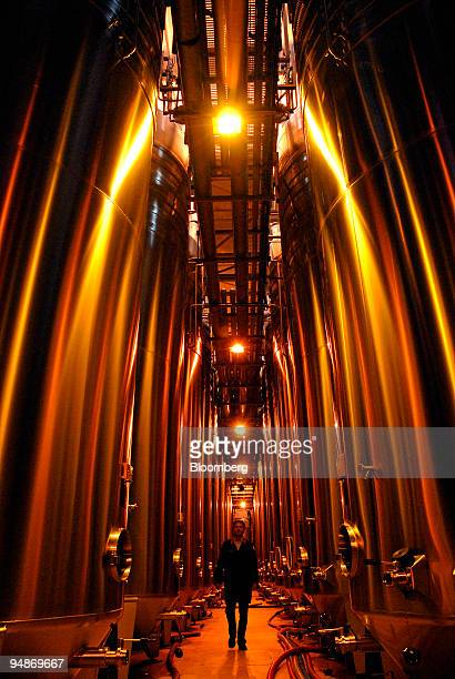 Worker walks through the blending vats room at the Piper-Heidsieck champagne factory, owned by Remy-Cointreau, in Reims, France, on Monday, July 21,...