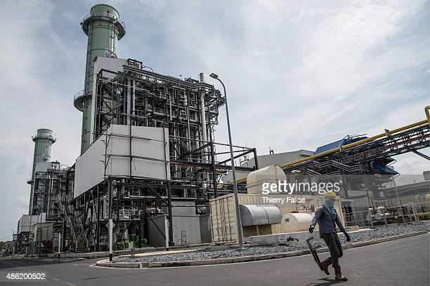 DISTRICT SONGKHLA THAILAND A worker walks through the Chana power plant Fuelled by natural gas from the Thailand Malaysia Joint Development Area the...