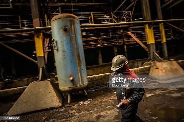 A worker walks through the Doe Run Peru refinery in La Oroya Peru on Thursday March 21 2013 Most of La Oroyaís children suffer elevated lead levels...