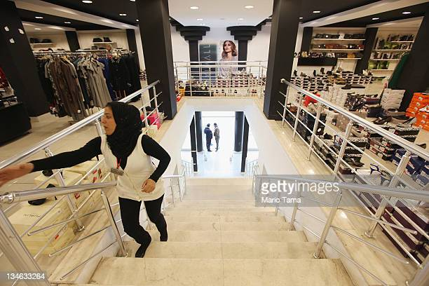 A worker walks through the new Maximall clothing store on December 3 2011 in Baghdad Iraq Iraq is transitioning nearly nine years after the 2003 US...
