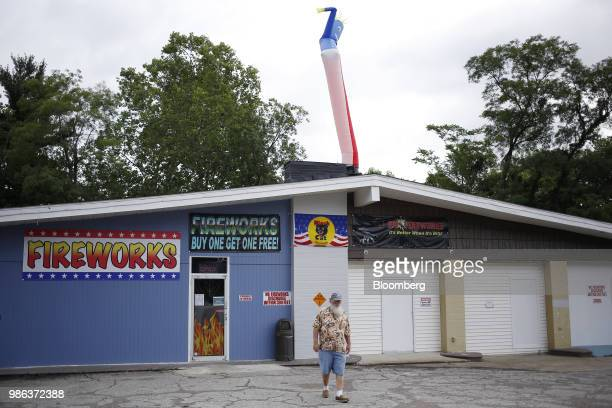 A worker walks through the parking lot of a fireworks store in Muldraugh Kentucky US on Wednesday June 27 2018 According to the American Pyrotechnics...