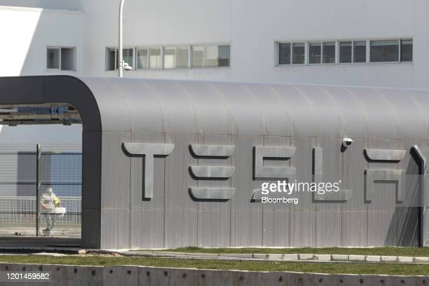 A worker walks through the Tesla Inc Gigafactory in Shanghai China on Monday Feb 17 2020 Tesla has fully resumed deliveries of its Chinabuilt model 3...
