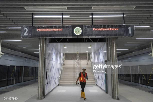 A worker walks through the under construction Jakarta Mass Rapid Transit Bundaran Hi station in the Thamrin area of Jakarta Indonesia on Thursday...