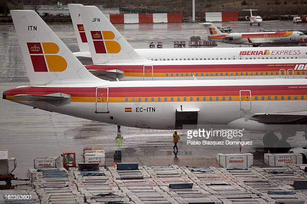 A worker walks under an Iberia plane at Barajas Airport on February 22 2013 in Madrid Spain Today is the last of a five day strike held by Iberia...