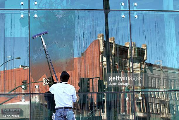 Worker washes the windows at the San Joaquin County buidling on June 27, 2012 in Stockton, California. Members of the Stockton city council voted 6-1...