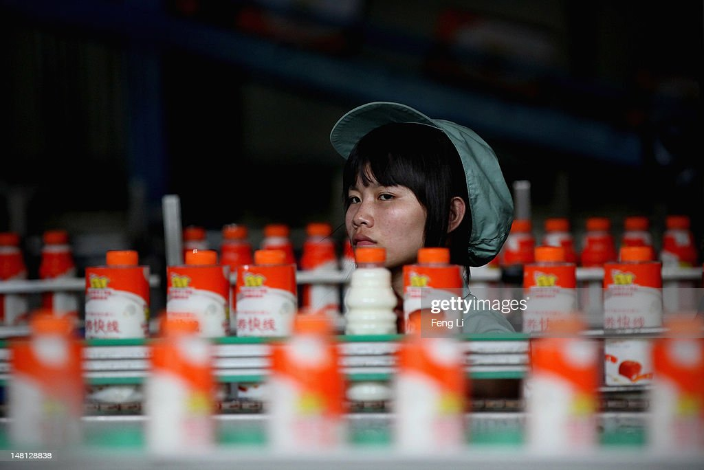 A worker watches bottles of a Wahaha milk drink on a production line of Wahaha Group Co., Ltd. on July 2, 2012 in Hangzhou of Zhejiang Province, China. Chinese Premier Wen Jiabao said Tuesday that stabilizing economic growth is the most pressing matter currently facing China. China's central bank's sudden cut in the benchmark interest rates for the second time in a month confirmed the pessimistic view of the current economic situation.