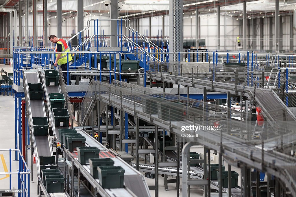 A worker watches boxes move along the assembly line in the giant semi-automated distribution centre where the company's partners process the online orders for the John Lewis department store on January 3, 2013 in Milton Keynes, England. John Lewis has published their sales report for the five weeks prior December 29, 2012 which showed online sales had increased by 44.3 per cent over the same period in 2011. Purchases from their website Johnlewis.com now account for one quarter of all John Lewis business.