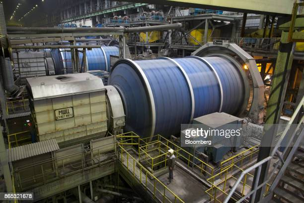 A worker watches mills as they rotate at the Talnakh concentrator plant operated by MMC Norilsk Nickel PJSC in Norilsk Russia on Wednesday Oct 18...