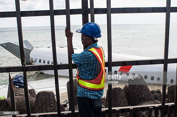 A worker watches the divers prepare to search CVR inside the Lion Air plane wreckage on April 15 2013 in Badung Bali Indonesia The Lion Air passenger...