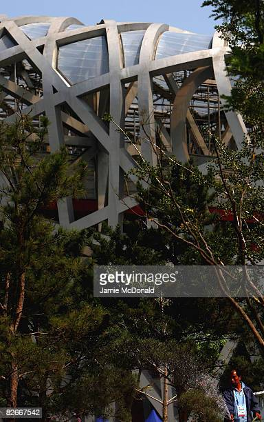 A worker waters the plants outside the National Stadium known as the 'Birdsnest' prior to tommorows Beijing Paralympic Games Opening ceremony at the...