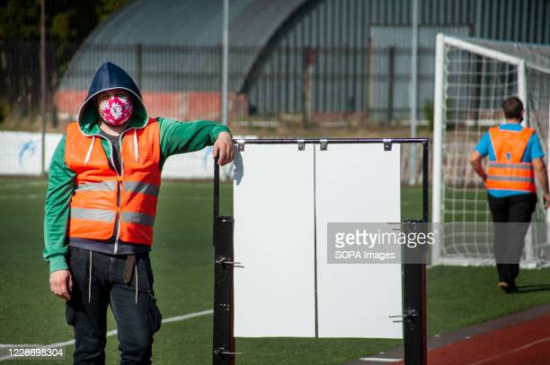 Worker wearing a face mask seen at the Lokomotiv stadium taking a rest while looking at the camera. Every day in Russia there is an increase in...