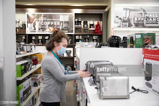 Worker wearing a protective mask organizes toasters for sale at a Kohl's Corp. Department store in Woodstock, Georgia, U.S., on Monday, Nov. 23,...