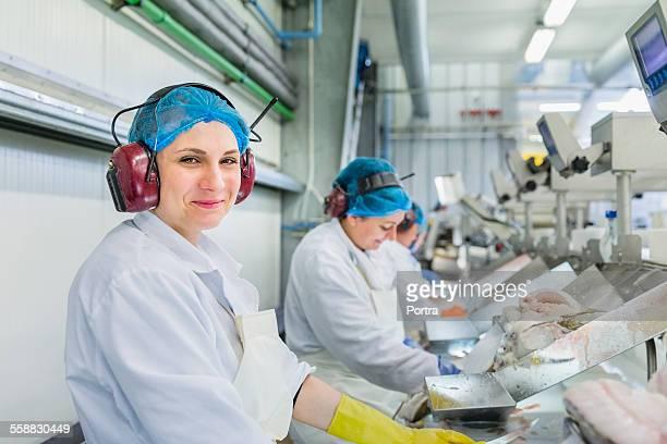 Worker wearing ear protectors in fishing industry