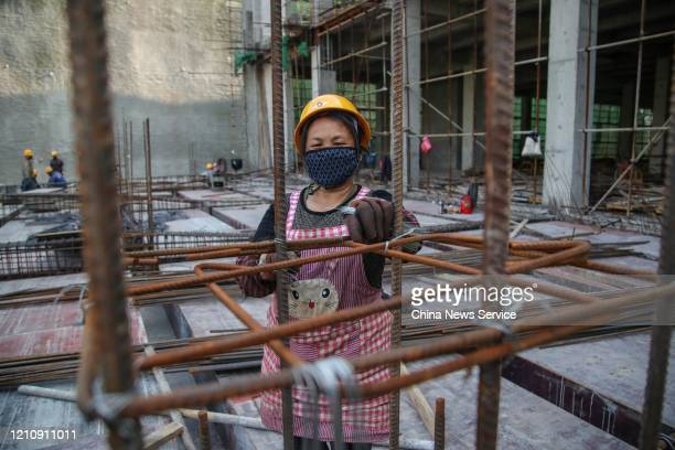 A worker wearing mask at the construction site of Huawei data center at Guian New Area on March 6 2020 in Guiyang Guizhou Province of China