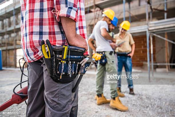 Worker wearing tool belt