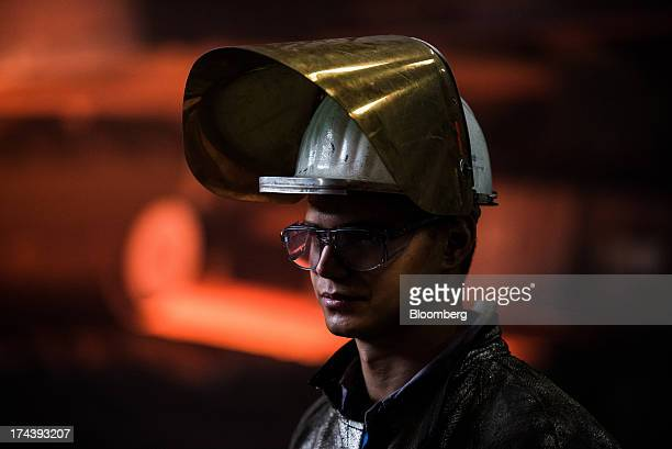 A worker wears a safety helmet and visor in the blast furnace shop at Voestalpine AG's steel plant in Linz Austria on Wednesday July 24 2013...