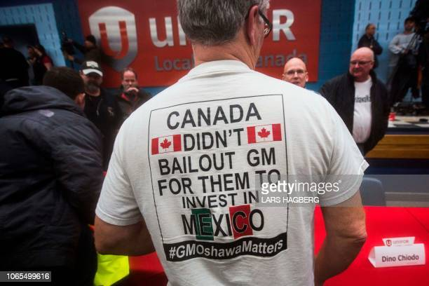 A worker wears a tshirt during a information session at Local 222 in Oshawa Ontario on November 26 2018 In a massive restructuring US auto giant...