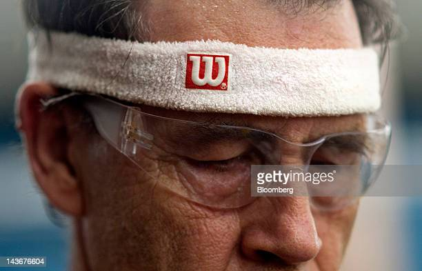 A worker wears a Wilson headband at the Wilson Sporting Goods Co Wilson Football Factory in Ada Ohio US on Wednesday May 2 2012 Since 1941 every NFL...