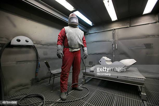 A worker wears protective clothing in the dry abrasive blasting facility during decommissioning operations at Lubmin nuclear power plant in...