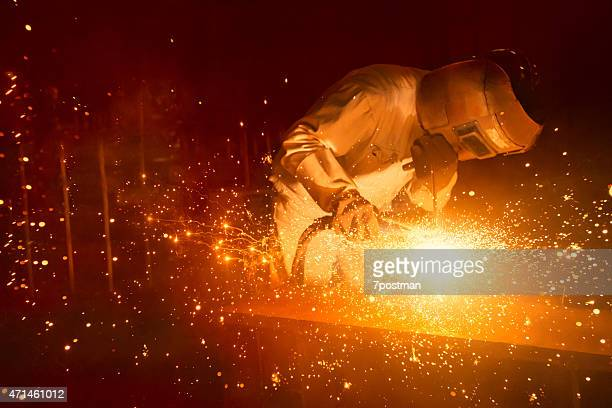 worker welding - in flames i the mask stock pictures, royalty-free photos & images