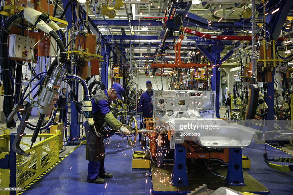 A worker welds a body section of a Chevrolet Aveo automobile, a division of General Motors Co. (GM), during production at the GAZ Group plant in Niznhy Novgorod, Russia, on Tuesday, Feb. 5, 2013. GAZ, which is controlled by Russian billionaire Oleg Deripaska, plans to make 30,000 Aveo sedans and hatchbacks a year at its plant in Nizhny Novgorod starting in mid-2012. Photographer: Alexander Zemlianichenko Jr./Bloomberg via Getty Images