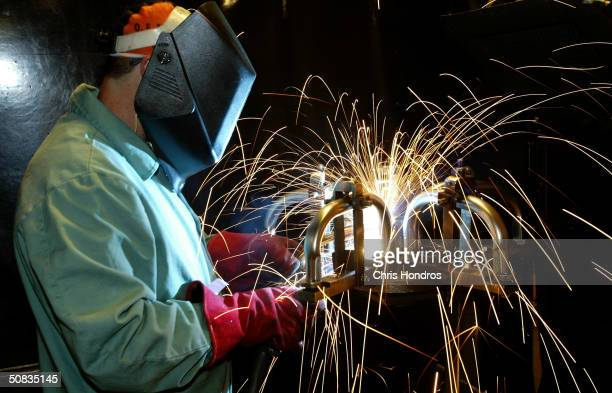 A worker welds a chair together at the Biofit Engineered Seating plant on May 13 2004 in Haskins Ohio Biofit began in 1993 manufacturing...