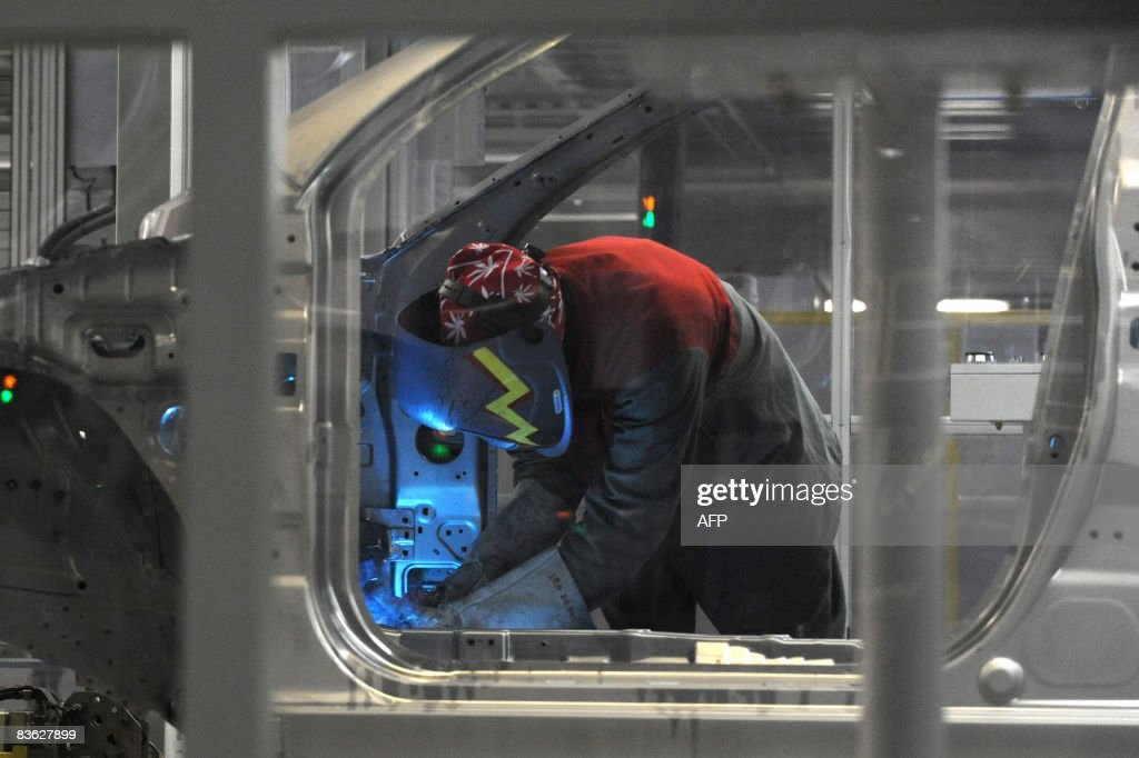 A worker welds a frame of ''i30'' Hyundai car at the joint