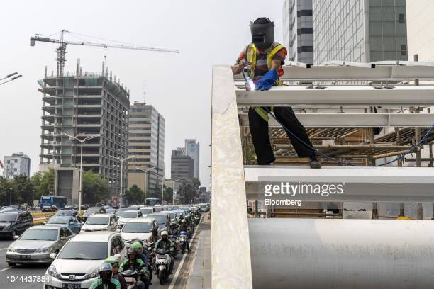 A worker welds at an entrance to an under construction Jakarta Mass Rapid Transit station in the Senayan area of Jakarta Indonesia on Thursday Sept...