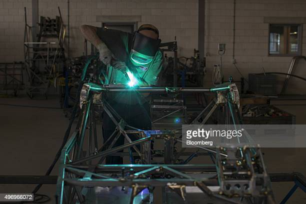 A worker welds the steel tubing of the chassis frame of a Donkervoort D8 GTO automobile at the Donkervoort Automobielen BV manufacturing facility in...