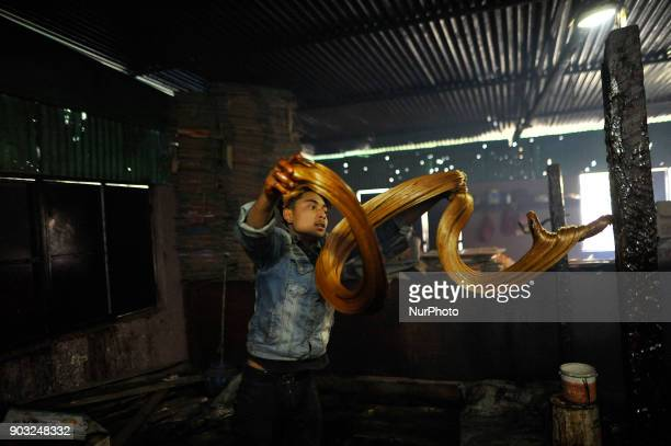 A worker whipping semi Hard molasses to molasses Chaku at Tokha Kathmandu Nepal on Wednesday January 10 2018 Molasses Chaku is usually prepared and...