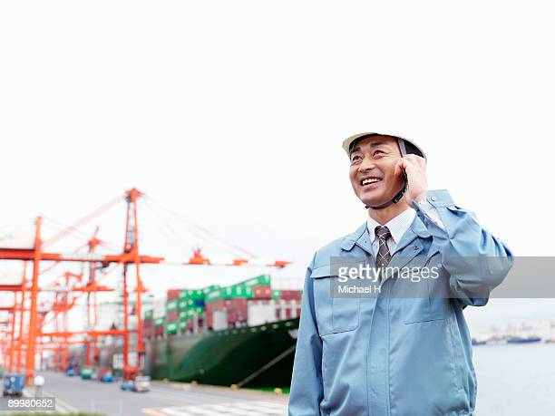 Worker who talks with cellular phone