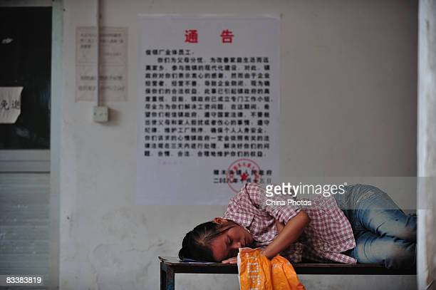 A worker who waits to get defaulted salary sleeps on a desk in the Junling Branch Factory of Smart Union Group Limited a Hong Kong listed company and...