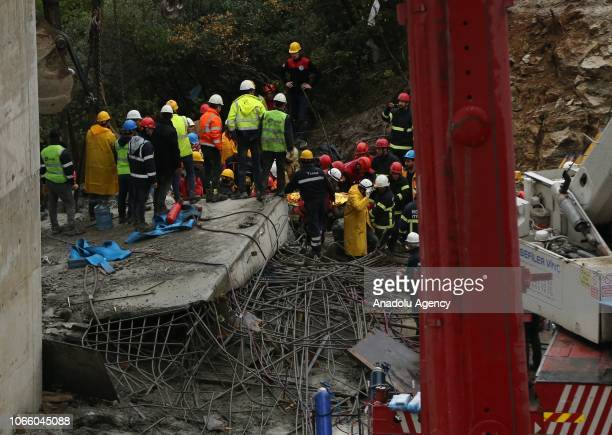 A worker who was rescued by officials is being taken away from the site after several workers were trapped under rubble when a concrete block dropped...