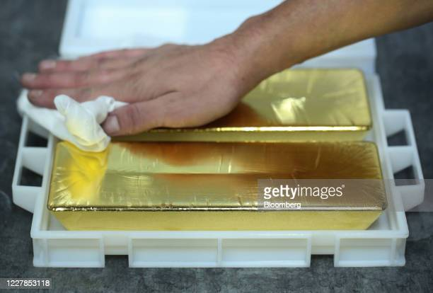 Worker wipes 12.5 kilogram gold ingots at the Uralelectromed Copper Refinery, operated by Ural Mining and Metallurgical Co. , in Verkhnyaya Pyshma,...