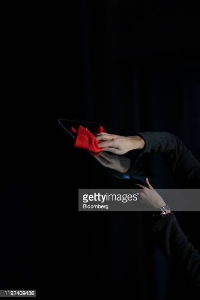 Worker wipes clean a teleprompter ahead of a news conference with former U.S. Vice President Joe Biden, 2020 Democratic presidential candidate, not...