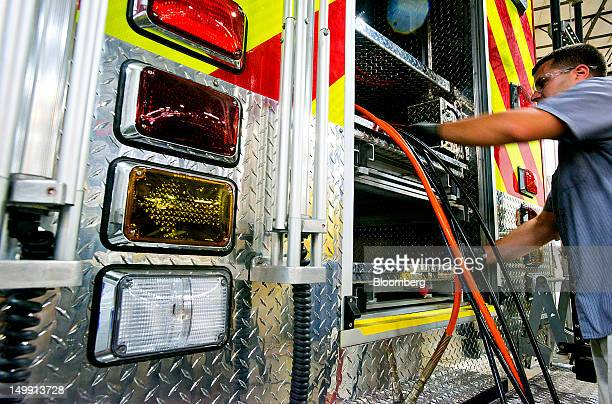 A worker wires up an ambulance module at the Horton Emergency Vehicles facility in Grove City Ohio US on Friday Aug 3 2012 Horton Emergency Vehicles...
