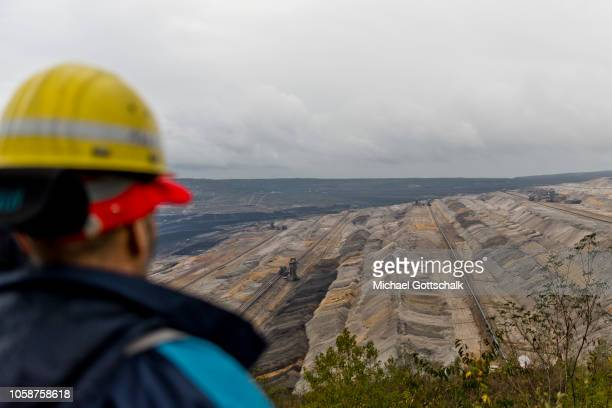 A worker with a safety helmet looks into the lignite opencast mine Hambach near the protest event of Coal miners and electricity plant workers of the...